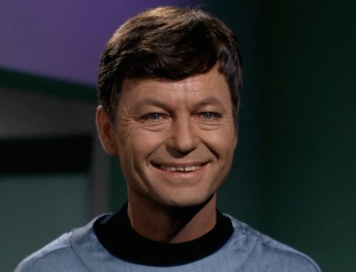 Screen grab of Dr. McCoy from the original star trek in a rare triumphant moment.