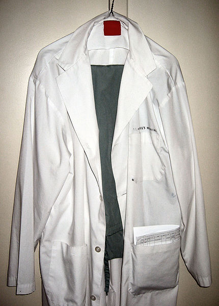 Wikimedia Commons says this picture is a white lab coat and scrubs, where 'scrubs' are the light cotton pants and shirts regularly worn by nurses, doctors, and medical students working in medical facilities.