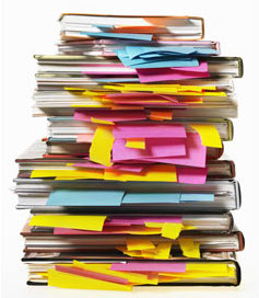 Picture of a pile of books stuffed with bookmarks and sticky notes, courtesy of www.keyword-suggestions.com.