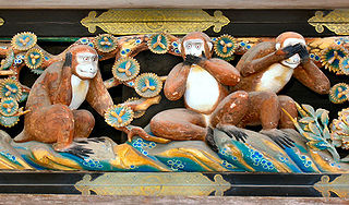 Photograph by MichaelMaggs of the three wise monkeys at toshu-gu shrine, japan.